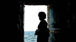Governor-General Michaelle Jean stares out of the Door of No Return on April 16, 2010, at a former slave trading post on Goree Island off the coast of Dakar, Senegal.