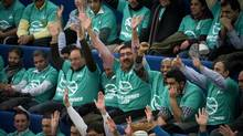 Taxi drivers cheer as councillors debate industry reform at Toronto City Hall on Feb. 19, 2014. (KEVIN VAN PAASSEN/THE GLOBE AND MAIL)