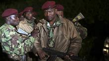 Kenyan soldiers hold their rifles near the Westgate shopping centre in Nairobi September 23, 2013. (REUTERS)