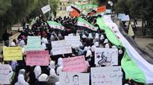 Demonstrators march against Syria's President Bashar al-Assad in Homs on Monday. (Reuters/Reuters)