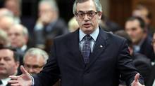 Treasury Board President Tony Clement stands in the House of Commons during Question Period, in Ottawa Thursday, February 6, 2014. (FRED CHARTRAND/THE CANADIAN PRESS)