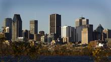 """Buildings stand in Montreal, Quebec, Canada, on Saturday, Nov. 5, 2011. Ivanhoe Cambridge confirmed Sunday it has """"voluntarily paused"""" preliminary excavation work at a downtown Montreal building site after a photographer expressed concerns the site may be an ancient aboriginal burial ground. (Brent Lewin/Bloomberg)"""
