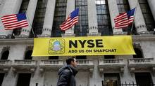 A Snapchat sign hands on the facade of the New York Stock Exchange in January. Parent company Snap Inc. will be the first technology listing of the year. (Brendan McDermid/Reuters)
