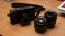 The Fuji X-Pro1 with a wide-angle 18mm f/2.0 lens, a 35mm f/1.4 – that, when the sensor's crop-factor is taken into account, is about equivalent to a 50mm lens – and a 60mm f/2.4. (Matthew Braga/The Globe and Mail)