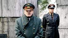 """Swiss actor Bruno Ganz as Adolf Hitler, left, and Heino Ferch as Albert Speer are seen as Adolf Hitler in the movie """"Der Untergang"""" (The Downfall). The film, which narrates Hitler's final days, has spawned hundreds of parody videos that publishing studio Constantin Film is seeking to have removed. (AP Photo/Constantin Film)"""