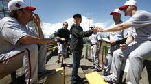 Brody Andersen-Tusche,13, with Victoria Seals players at Royal Athletic Park, in Victoria, Saturday. (Deddeda Stemler for the Globe and Mail/Deddeda Stemler for the Globe and Mail)