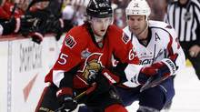 Ottawa Senators' Erik Karlsson (front) moves the puck towards the net as Washington Capitals' Mike Knuble looks to steal it during the second period of their NHL hockey game in Ottawa February 22, 2012. (BLAIR GABLE/Reuters)