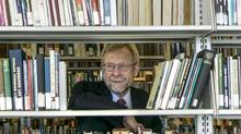 Tom Hickerson, head librarian at the University of Calgary, has watched in horror over the past two years as the falling dollar eats into his library's purchasing power. Every one cent drop against the American dollar takes a $100,000 bite out of his acquisitions budget. (Chris Bolin For The Globe and Mail)