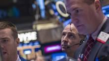 Traders work on the floor of the New York Stock Exchange, November 15, 2013. (BRENDAN MCDERMID/REUTERS)