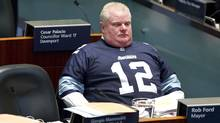 Toronto Mayor Rob Ford wears an Argos jersey as he sits in council Nov 14, 2013 at City Hall. (Moe Doiron/The Globe and Mail)