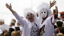Phoenix Coyotes fans cheer at a game in Glendale, Ariz. (Rick Scuteri/Reuters)