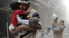 Children are rescued after what activists say was an air strike by forces loyal to Bashar al-Assad in Aleppo June 2, 2014. (SULTAN KITAZ/Reuters)