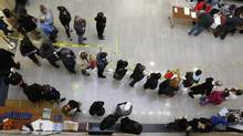 Voters stand in line to cast their ballots for the U.S. presidential election in Richmond Public Library in Richmond, Va., on Tuesday. (JONATHAN ERNST/REUTERS)