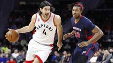 Toronto Raptors forward Luis Scola drives to the basket against Detroit Pistons forward Justin Harper during the first quarter at The Palace of Auburn Hills on Feb. 28. (Raj Mehta/USA Today Sports)