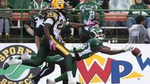 Saskatchewan Roughriders wide receiver Taj Smith is not able to grab a pass as Edmonton Eskimos corner back Robert Sands provides coverage during the third quarter of CFL pre-season football action at Mosaic Stadium on Friday, June 20, 2014 in Regina. (Liam Richards/THE CANADIAN PRESS)