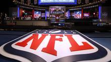 A large NFL logo decorates the stage before the first round of the NFL football draft at Radio City Music Hall, Thursday, April 25, 2013, in New York. According to Sports Media Watch , viewership for last week's games was down 26 per cent for Monday night, 15 per cent for Sunday night (against the second presidential debate) and 20 per cent for Thursday night. Overall, for the first four weeks of the season, ratings across the league were down 11 per cent. (JASON DECROW/AP)