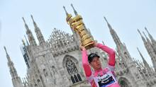 Canada's Ryder Hesjedal holds the trophy after winning the 95th Giro d'Italia, Tour of Italy cycling race, in Milan, Italy, Sunday, May 27, 2012. (Daniele Badolato/Daniele Badolato/AP)