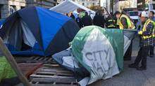 City workers remove a tent at the Occupy Vancouver protest site that did not comply with the fire code in Vancouver, British Columbia November 15, 2011. (Andy Clark/ Reuters/Andy Clark/ Reuters)