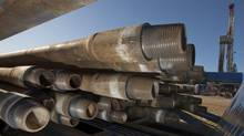 Drill pipes are stacked on a trailer at the Pembina oil field near Pigeon Lake, Alta., in this file photo. (Norm Betts/Bloomberg)