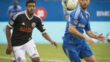 Montreal Impact's Marco Di Vaio is dogged by Philadelphia Union's Sheanon Williams during 1st half MLS action in Montreal Saturday, October 19, 2013. (PETER MCCABE/THE CANADIAN PRESS)