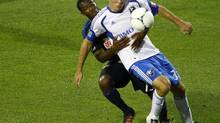 Philadelphia Union's Freddy Adu fights for the ball against Montreal Impact's Andrew Wenger (R) during the first half of their MLS soccer match in Montreal, August 4, 2012. REUTERS/Olivier Jean (OLIVIER JEAN/REUTERS)