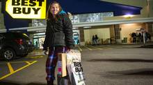 """A Canadian leaves Best Buy in Tonawanda, New York, at around three o'clock in the morning during """"Black Friday,"""" on November 23, 2012. JENNIFER ROBERTS FOR THE GLOBE AND MAIL (JENNIFER ROBERTS For The Globe and Mail)"""