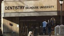 Students head to the Dalhousie University dentistry building in Halifax on Tuesday, Jan.6, 2015. There are renewed calls for the expulsion of more than a dozen male dentistry students at the school after they allegedly posted misogynistic comments about their female colleagues on Facebook. The Alberta Dental Association and College has joined Ontario's dental regulatory body to call on Dalhousie's dentistry faculty to release the names of the 13 students involved in the scandal. (Andrew Vaughan/THE CANADIAN PRESS)