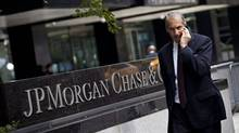 A man walks past JP Morgan Chase's international headquarters on Park Avenue in New York in this July 13, 2012, file photo. (ANDREW BURTON/REUTERS)