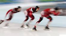 Canadian speedskater Lucas Makowsky, centre, skates between Denny Morrison, right, and Mathieu Giroux, left, during the men's team pursuit semi-finals at the Olympic Winter Games in Richmond, B.C., Friday Feb. 26, 2010. (Adrian Wyld/THE CANADIAN PRESS)