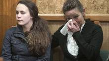 Kirstie Van Diest, left, Taylor Van Diest's twin sister, and Marie Van Diest, Taylor's mother, listen to an RCMP news conference in Armstrong , B.C., on Wednesday, April 5, 2012. (Jeff Bassett for The Globe and Mail/Jeff Bassett for The Globe and Mail)