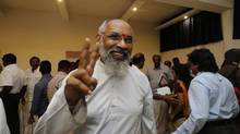 Chief Minister-elect for Sri Lanka's northern provincial government, retired Supreme Court Justice C.V. Wigneswaran flashes a victory sign following a media briefing in Jaffna, Sri Lanka, Sunday, Sept. 22, 2013. The Tamil National Alliance, a former political proxy for Sri Lanka's defeated Tamil Tiger rebels swept the country's northern provincial election, according to results released Sunday, in what is seen as a resounding call for wider regional autonomy in areas ravaged by a quarter century of civil war. (AP Photo/Eranga Jayawardena) (Eranga Jayawardena/AP)