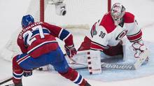 Carolina Hurricanes goaltender Cam Ward makes a save against Montreal Canadiens' Alex Galchenyuk during third period NHL hockey action in Montreal, Thursday, November 24, 2016. (Graham Hughes/THE CANADIAN PRESS)