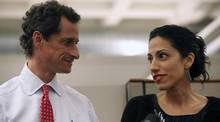 Huma Abedin, right, and Anthony Weiner speak during a news conference on July 23, 2013, in New York City. (John Moore)