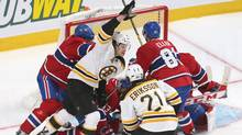 Boston Bruins forward Matt Fraser celebrates after scoring the winning goal in overtime against the Montreal Canadiens in Game 4 of their second-round NHL playoff series on Thursday, May 8, 2014, in Montreal. (Jean-Yves Ahern/USA Today Sports)