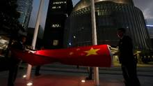 A Chinese national flag is lowered outside Legislative Council during a daily flag lowering ceremony in Hong Kong on November 7, 2016. (BOBBY YIP/REUTERS)