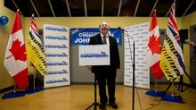 Conservative candidate John Martin steps to the podium to concede to NDP candidate Gwen O'Mahony at his campaign office in Chilliwack, B.C., on April 19, 2012. (DARRYL DYCK for The Globe and Mail)