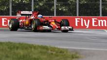 Ferrari driver Fernando Alonso drives through turn eight during a practice session at the Canadian Grand Prix on June 7 in Montreal. (David J. Phillip/AP)
