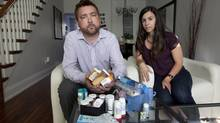 Erick Bauer (with his wife Stefani Cali) takes 60 to 70 pills daily for cystic fibrosis. (Deborah Baic/The Globe and Mail)