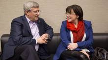 Conservative party advisor Jenni Byrne speaks with Prime Minister Stephen Harper in this undated photo from the Prime Minister's Office. (PMO)