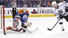 Los Angeles Kings' Jeff Carter (77) is stopped by Edmonton Oilers goalie Viktor Fasth (35) during first period NHL hockey action in Edmonton, Alta., on Thursday April 10, 2014. (JASON FRANSON/THE CANADIAN PRESS)