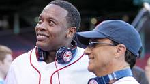 Producer and musician Dr. Dre and Interscope and Geffen Records chairman Jimmy Iovine are on the field before the Boston Red Sox take on the the New York Yankees on April 4, 2010. (Elsa/Elsa / Getty Images)