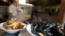 Moules frites at Bistro Wagon Rouge in Vancouver, British Columbia, Thursday, January 30, 2014. (Rafal Gerszak For The Globe and Mail)