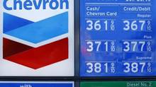 Chevron guts budget as job cuts, project delays follow oil slump