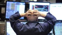 New members of the Dow Jones industrial average represent almost 15 per cent of the stock-weighted U.S. index. (RICHARD DREW/AP)