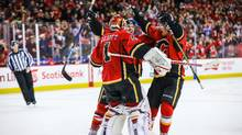 Calgary Flames goalie Brian Elliott celebrates with teammates after beating the Pittsburgh Penguins on Monday night. (Sergei Belski/USA Today Sports)