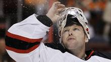 New Jersey Devils goalie Martin Brodeur blows water into the air before the second period of Game 5 of a second-round NHL hockey Stanley Cup playoff series against the Philadelphia Flyers, Tuesday, May 8, 2012, in Philadelphia. (AP Photo/Matt Slocum) (Matt Slocum)
