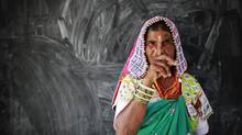 A tribal woman shows her ink-marked finger after voting at a polling centre during the seventh phase of India's general election, in Rangareddy district in the southern Indian state of Andhra Pradesh April 30, 2014. Around 815 million people have registered to vote in the world's biggest election - a number exceeding the population of Europe and a world record - and results of the mammoth exercise, which concludes on May 12, are due on May 16. (DANISH SIDDIQUI/REUTERS)