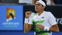 Milos Raonic of Canada celebrates defeating Philipp Kohlschreiber of Germany during their men's singles match at the Australian Open tennis tournament in Melbourne January 19, 2013. (NAVESH CHITRAKAR/REUTERS)