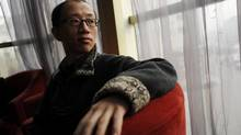 Chinese activist and dissident Hu Jia speaks during an interview in Beijing on March 16, 2012. (KEITH BEDFORD For The Globe and Mail)
