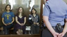 Feminist punk group Pussy Riot members, from left, Nadezhda Tolokonnikova, Maria Alekhina and Yekaterina Samutsevich in a glass cage inside a Moscow court room on Aug. 8, 2012. Prosecutors have called for three-year prison sentences for feminist punk rockers who gave an impromptu performance in Moscow's main cathedral to call for an end to Vladimir Putin's rule. Today's topics: (Misha Japaridze/AP)